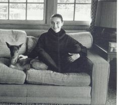Audrey and Ip sitting on the couch. (Portrait) Date: 1959.