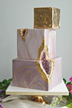 From cool marble and geode designs like this square wedding cake to elaborate six tier wedding cakes, there really is no brief that The Custom Cake Boutique can't work with. Beautiful wedding cakes for any type of wedding wedding Square Wedding Cakes, Floral Wedding Cakes, Square Cakes, Elegant Wedding Cakes, Wedding Cake Designs, Wedding Cake Toppers, Cake Wedding, Wedding Ceremony, Gold Wedding
