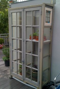 I think i will have to make one of these only model it after the Dr who tardis is part of Indoor greenhouse - Diy Greenhouse Plans, Outdoor Greenhouse, Backyard Greenhouse, Small Greenhouse, Recycled Door, Recycled Windows, Greenhouse Interiors, Diy Fence, Fence Ideas