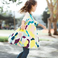 Balla Abstract Skater Dress | Giacomo Balla is an Italian artist known for his role in the Futurism movement. In his iconic abstract artwork, he set out to capture light, speed and motion. This brightly colored dress is inspired by his aesthetic.
