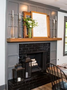Fixer Upper: Old-World Charm for Newlyweds The existing brick fireplace was retained but updated with black interior, new trim in dark gray and a reclaimed wood mantel. Grey Fireplace, Fireplace Surrounds, Fireplace Design, Brick Fireplaces, Fireplace Trim, Fireplace Update, Fireplace Ideas, Reclaimed Wood Mantel, Wood Mantels