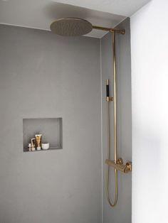brass fitting in grey bathroom