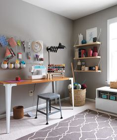 A Sewing Zone With Not a Stitch of Wasted Space: After | The work space/craft room of Pennsylvania newlywed Jess Mauras (shown here with husband Joe) was a pile of stress and ribbons, devoid of inspiration—and, for that matter, shelving. Real Simple transformed it into three tidy zones that foster calm and creativity.