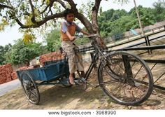 Indian kid sitting on a cart