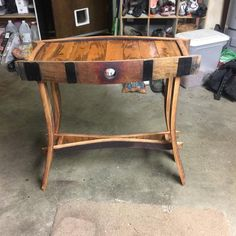 This table has been created from wine barrel staves. It will fit in beautifully with other wine-related or rustic decor. It weighs about 10 pounds. Whiskey Barrel Decor, Wine Barrel Chairs, Whiskey Barrel Furniture, Barrel Coffee Table, Whiskey Barrels, Bourbon Barrel, Wine Barrel Fire Pit, Wine Glass Rack, Wine Rack