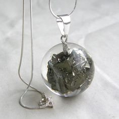 Pyrite in resin pendant.   I want this. really bad.   http://www.earthbow.com/crystals/pyrite.htm