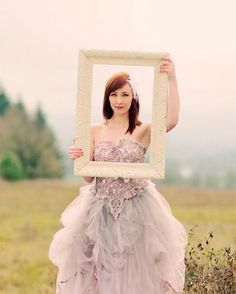 Ornate lilac wedding dress with beaded corset and a ruffled tulle skirt. #wedding #dress