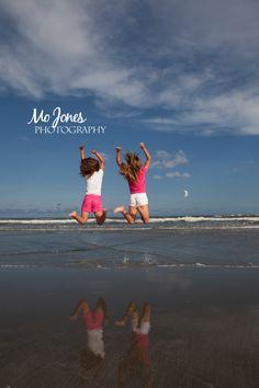 beach photography poses, beach family photography, girls jumping © Mo Jones Photography   Charleston