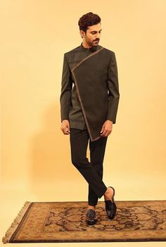 Top Wedding Dresses for Men - We're majorly crushing over this angrakha bandhgala suit with pin-tuck texturing and subtle embro - Wedding Dress For Boys, Indian Wedding Clothes For Men, Wedding Suits, Desi Wedding, Indian Men Fashion, Mens Fashion Suits, India Fashion Men, Groom Fashion, Marriage Dress For Men