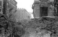 """Warsaw Uprising: Wojciech Sarnecki """"Wojtek"""" (facing backward) with group of soldiers from """"Anna"""" Company of """"Gustaw"""" Battalion in the trench along Marszałkowska Street at the intersection with Piękna Street (aka. Piusa XI). #WWII, #WW2, #Poland, #Warsaw"""