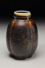 Porcelain Tenmoku Vase, wheel formed and altered, wood/soda/salt fired by David Voorhees