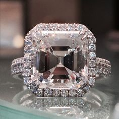 Asscher cut diamond engagement ring.  Stunning 5.01 asscher cut diamond surrounded by diamond pave. Call Alson Jewelers at 216-464-6767 for more information.