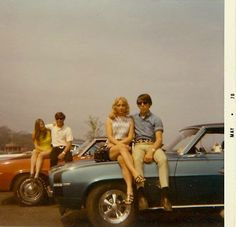 Two 69 Camaros - May 1970 and their teen owners with girlfriends.