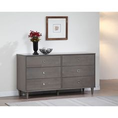 Mid-century modern gets a contemporary update with this gorgeous Marley 6-drawer dresser. With six spacious drawers sporting stainless steel drawer pulls, this unit is finished in a neutral light charcoal grey to complement a variety of bedroom decors.