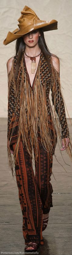 JAP is obsessed with this Donna Karan look coming down the runway in New York for S/S 2014. Loving the bohemian fringe and leather hat!