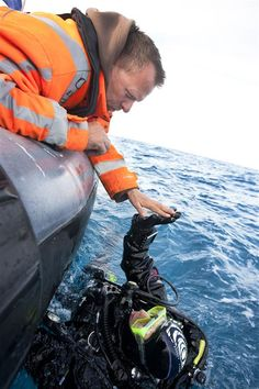Marking Marine Reserve in the North Sea. Greenpeace crew member Theo de Winter greets diver Manuel Marinelli before his descent to the sea bottom of Cleaver Bank in the North Sea. Greenpeace monitors the flora and fauna on the seabeds in this area as part of the SOS North Sea campaign. Photographer: Greenpeace / Cris Toala Olivares