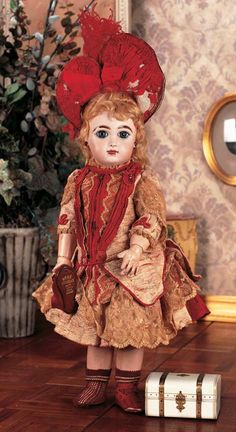 "Depose Tete Jumeau Bte SGDG 8.  Silk couturiere costume from the Ernestine Jumeau studios, original matching bonnet, pleated muslin under-ruffle, Jumeau chemise, pantalettes, Jumeau maroon stockings, silk maroon shoes with gold stamp ""Bebe Jumeau."""