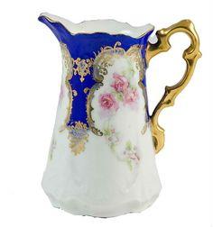 Art Nouveau Edwardian porcelain milk jug with painted floral decorations and gilt, England