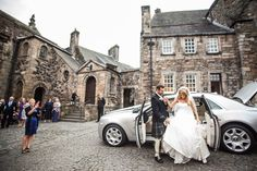 the groom holds his brides hand to help her get out of their wedding car Stirling Castle, Wedding Car, Getting Out, Brides, Groom, Street View, Wedding Photography, In This Moment, Building