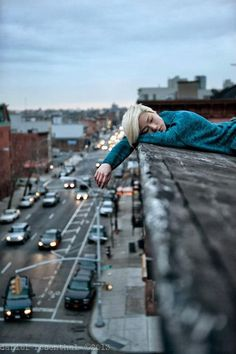 Keeping warm on the rooftops in Brooklyn, NY Photographer: Daniel Rosenthal…