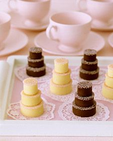 """Mini Fudge Cakes - Delight guests with their own tiered """"cake."""" For these fudge treats, which can be made with white or dark chocolate, cookie cutters form bite-size layers. Pink sanding sugar serves as icing, and paper doilies enhance the dainty display. Mini Wedding Cakes, Mini Cakes, Cupcake Cakes, Baby Cakes, Cupcake Ideas, Wedding Cupcakes, Fudge Cake, Mini Desserts, Keto Desserts"""
