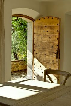 Old wooden door opening on the garden. Bastide in ancient Provence. Wooden table, old chair. Old Wooden Doors, Wooden Windows, Old Doors, Windows And Doors, Rustic Doors, Sliding Doors, Wooden Door Design, Wooden Wall Decor, Ikea Wall