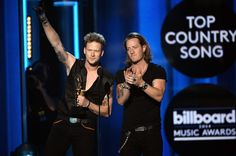 """Florida Georgia Line accept the Top Country Song award for """"Cruise"""" at the 2014 Billboard Music Awards."""