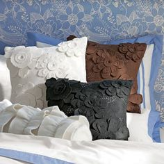 easy to re create...... buy plain pillow ( whatever color you what), buy felt, cut out felt petal shapes, stitch onto pillow or if sewing scares you, could even hot glow petals onto pillow!