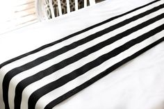 SPECIAL ORDER- SHIPS IN 5-7 BUSINESS DAYS  This black and white vertical stripe table runner is the perfect compliment to your décor. It has