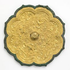 Back of a Tang Dynasty mirror, Gold Foil over Bronze. #DecorativeChineseArt #ChineseDesign