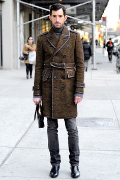 Shearling Full Length Coat over Cotton Cashmere Sweater, and Leather Carryall. Comfortable and Handsome City Street Style during New York Fashion Week.