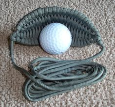 1 Handmade 550 Paracord Golf ball sling/thrower. Sling comes with 3 1/2 arms and pouch measuring 5 x 2.Tired of throwing the ball all day for