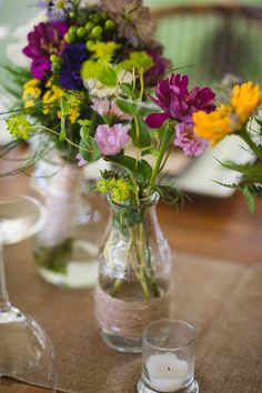 Wild flowers in various sized containers lined the Kings Tables adding spontaneous splashes of delightful color! East Aurora, Wild Flowers, Glass Vase, Tables, June, Wedding, Beautiful, Color, Design