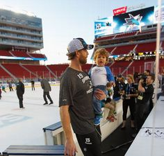 San Jose Sharks forward Joe Thornton with his son after practice at Levi's Stadium (Feb. 20, 2015).
