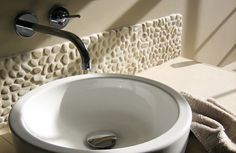 White pebble tile bathroom backsplash