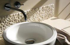 White pebble tile bathroom backsplash