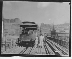 12th Street Viaduct, 1913 - All ages posed for a photo on the walking path between the cable tracks of the 12th Street incline on its last day of operation - 10/12/1913