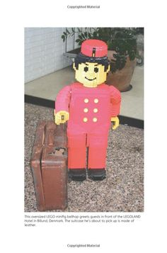 """An oversized LEGO mini-figure bellhop greets guests in front of the LEGOLAND Hotel in Billund, Denmark.  (The suitcase is leather.)    - photo from """"LEGO: A Love Story"""" by Jonathan Bender"""