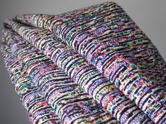 Glitches in the cold, hard logic of digital circuits transformed into warm blankets, textiles, rugs, and more.