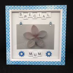"""White wooden scrabble letters saying """"Special Mum"""" with hand painted wooden blue & white flowers. Two wooden flower pegs to hold a inch photo. Photo for demonstration use only. Scrabble Letters, Wooden Flowers, Mothers Day Presents, White Flowers, Gift Guide, Blue And White, Hand Painted, Frame, Picture Frame"""