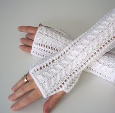 Knitting pattern for Lace Fingerless Gloves - These elegant gloves only use one ball of worsted weight yarn.