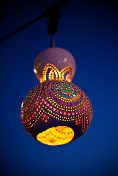 Gourd Lights- Part 1. Whoa... looks like carved, pierced gourd with tissue paper behind it to make the colors... intense!