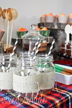 Camping party; definitely want to do mason jar cocktails. I like the way these are decorated.