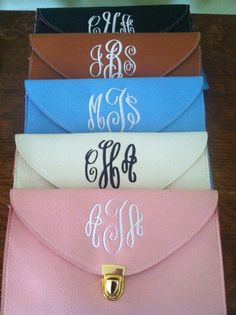 Monogrammed clutch- the brown one please! white stiching with my monogram <3