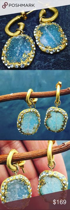 """Blue pave Druzy with 24k gold leaf and crystals Oh my what a gorgeous pair of earrings. I love these ones. Blue Druzy with a halo of 24k gold leaf pave with Swarovski crystals. These are hanging on an organic formed hoops with matte 24k gold finish. The coating is 1 micron for extra durability. These are hypoallergenic. Length 1"""". Please note stone may vary due to natural cut of stones Matana  Jewelry Earrings"""