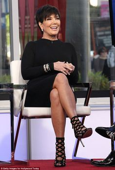 Brave face: Kris Jenner appeared on Hollywood Today Live on Tuesday and she couldn't stop laughing and beaming for the camera
