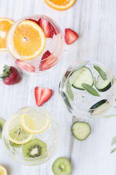 Fruit-Infused Gin and Tonic Cocktails  - Strawberry & Orange  - Cucumber & Sage  - Kiwi & Lemon