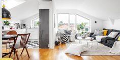 Mieszkanie moze juz nie takie male, ale z fajnie rozdzielonymi strefami. Podloga w szachownice, wbudowana wneka z szarymi drzwiami i proste, oszczedne dodatki.