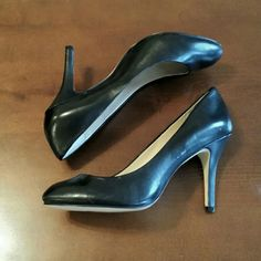 Black Leather Aldo Pumps Black leather rounded toe pumps. Worn once inside only. No wear on soles. Scratches on leather of toe as seen in the third picture and on side of shoe in 4th picture. ALDO Shoes Heels