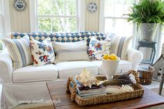White sand walls, white slipcovers, blue and white pillows and throw. Blue And White Pillows, English Decor, Savvy Southern Style, White Sofas, Cottage Style, Cozy Cottage, Cozy House, Vintage Quilts, Living Spaces